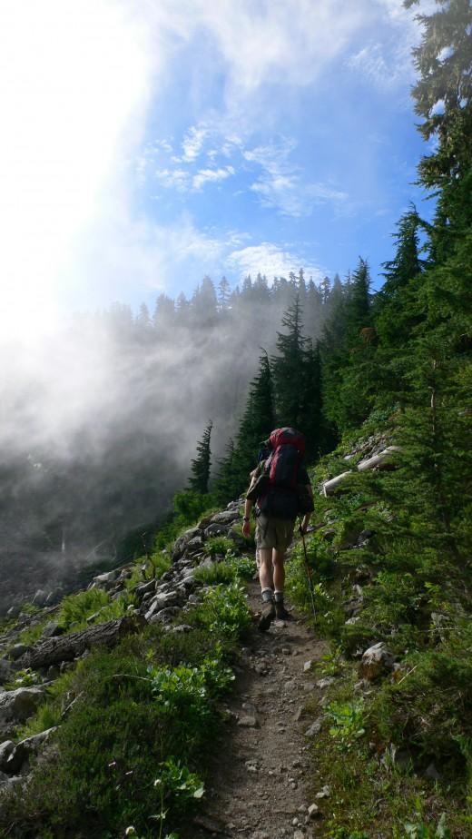 Backpacker on steep hillside